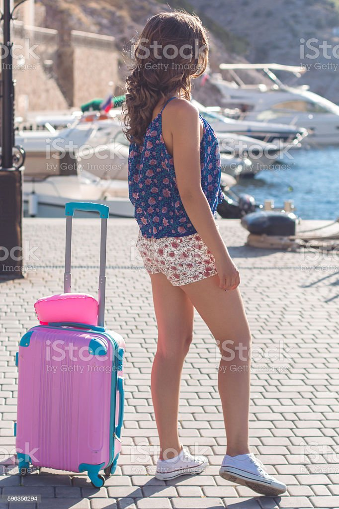 Back view girl with pink suitcase royalty-free stock photo