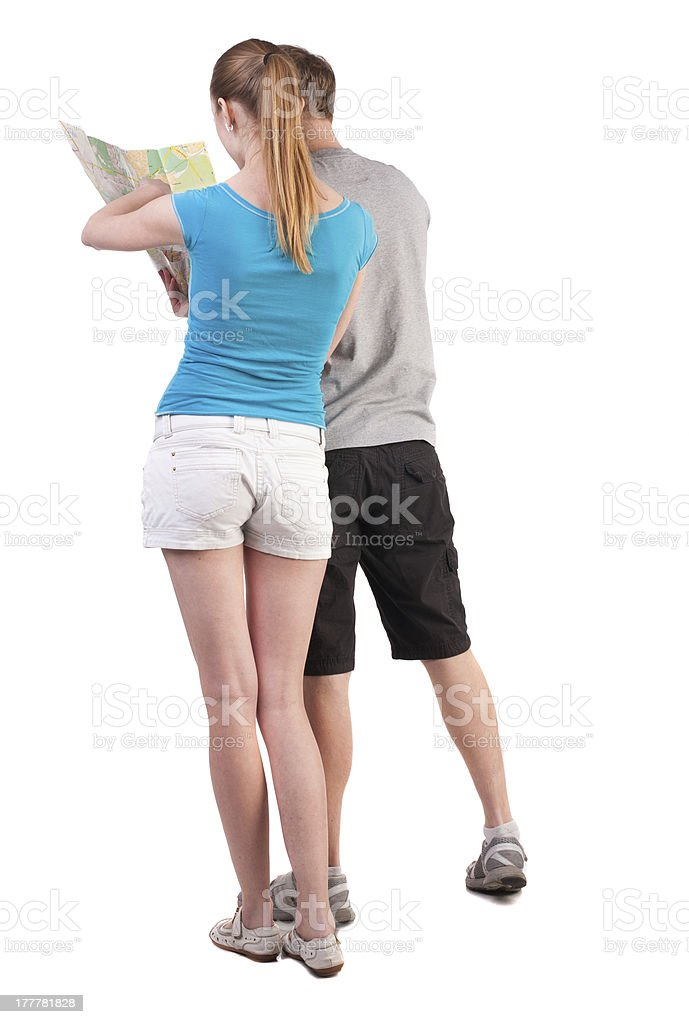 Back view journey of the young couple looking at map royalty-free stock photo