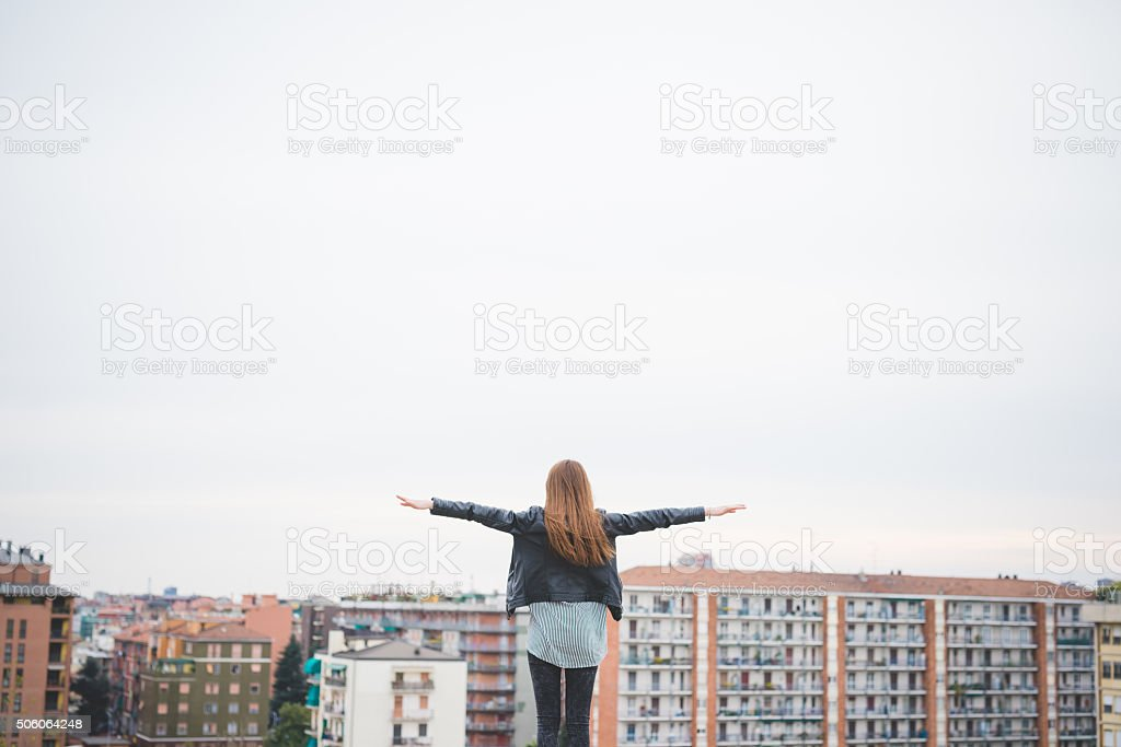 Back view knee figure of young beautiful eastern brunette girl stock photo