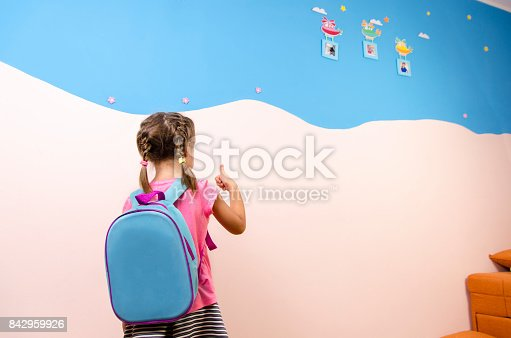 istock Back view, little girl with pigtails and backpack, preschool 842959926