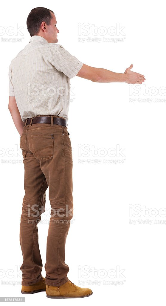 back view man in  movement reaches out to shake hands royalty-free stock photo