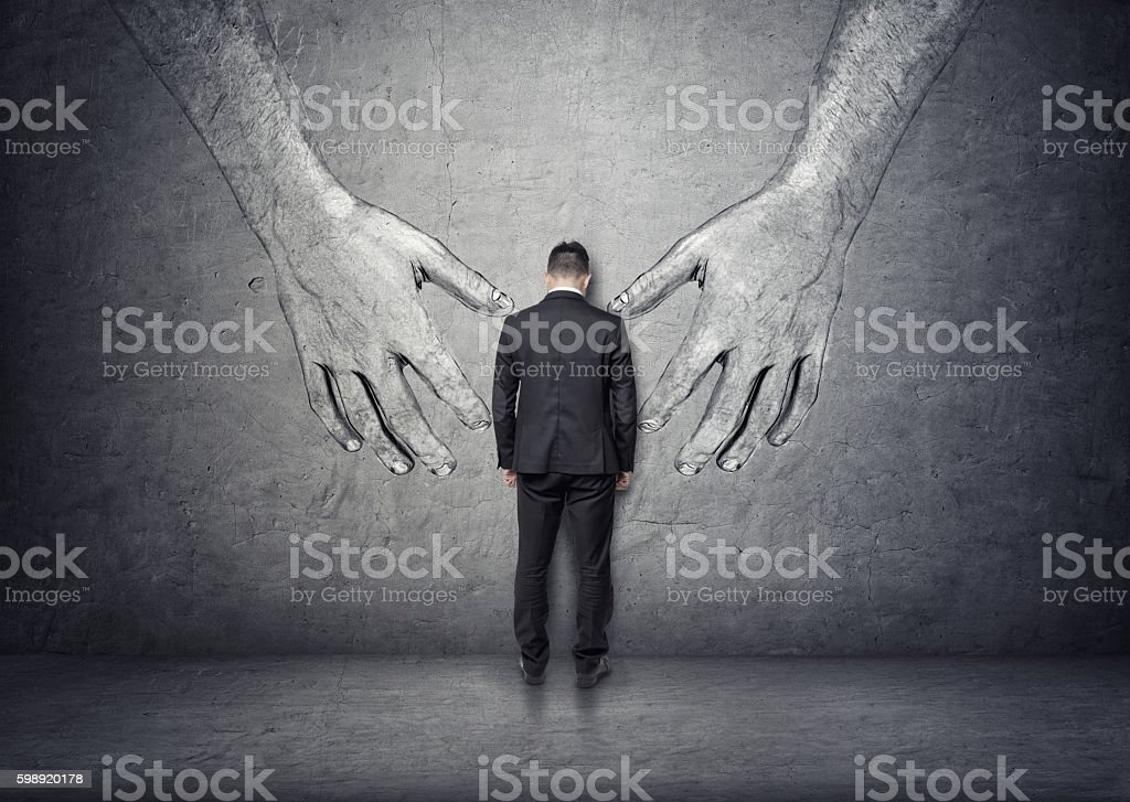 Back view of a businessman standing between big hand drawn stock photo