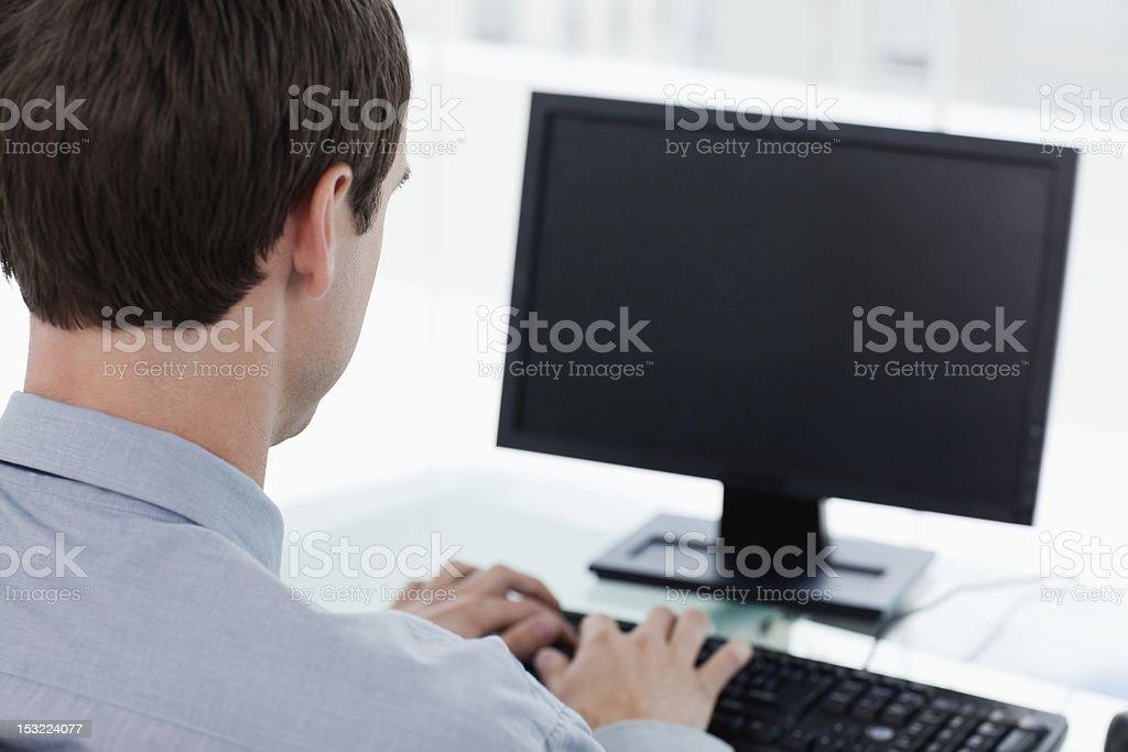 Back view of a businessman working on the computer royalty-free stock photo