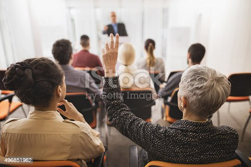 istock Back view of a businesswoman asking a question on seminar. 496851962