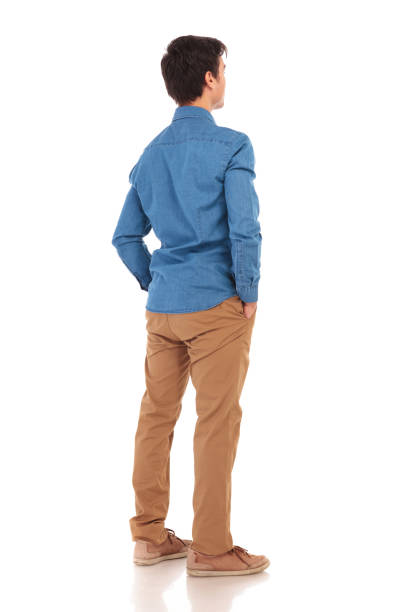 back view of a  casual man with hands in pockets - rear view stock photos and pictures