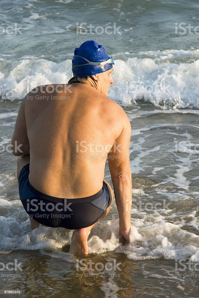 Back view of a male swimmer. stock photo