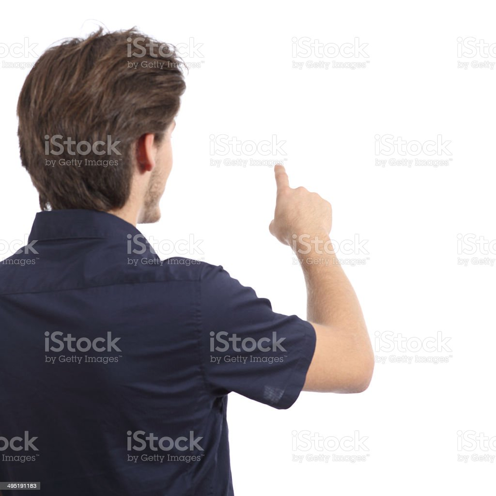 Back view of a man pushing button in the air stock photo