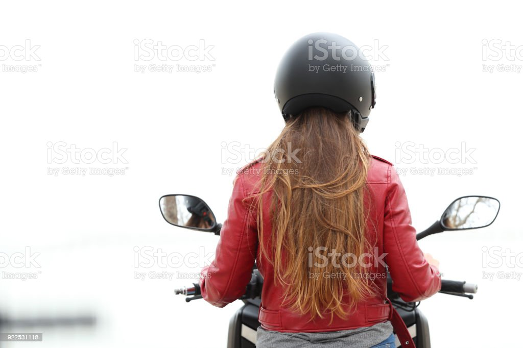 Back view of a motorbiker on a motorcycle on white stock photo