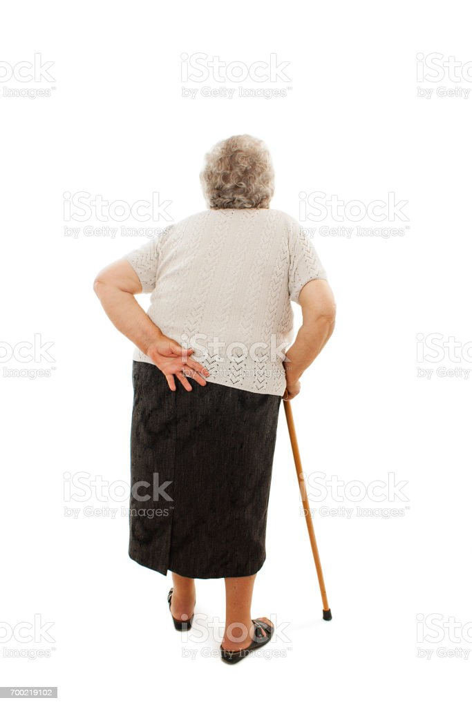 Back view of a old woman with a cane looking up. Rear view people collection stock photo