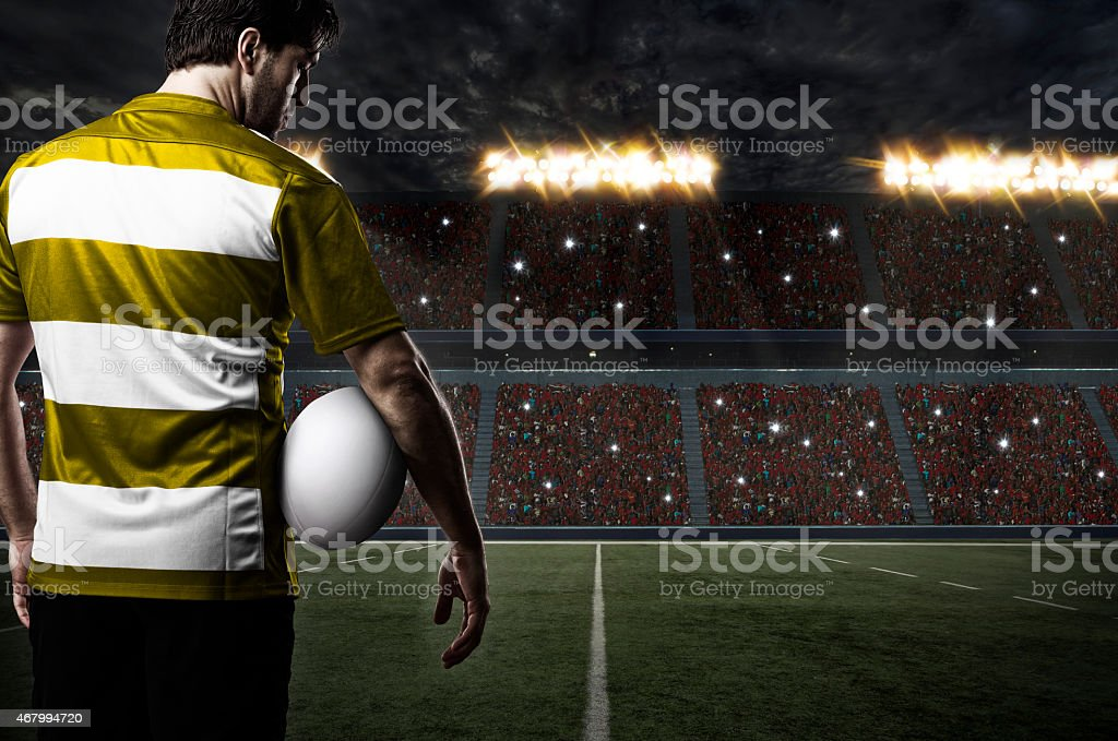Back view of a rugby player in a filled stadium stock photo