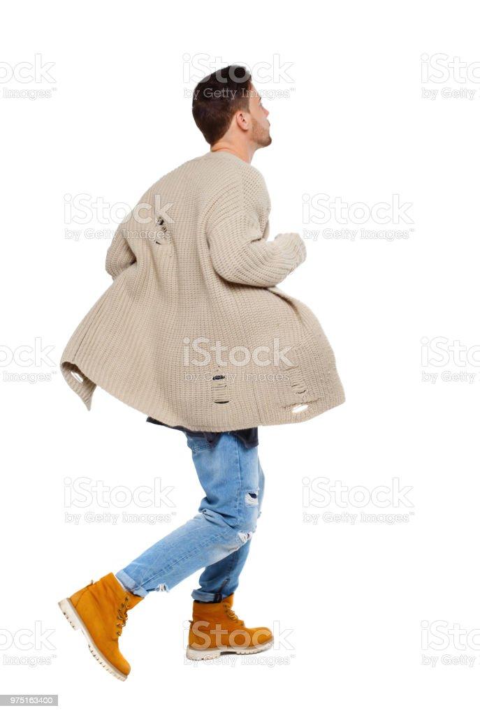 9bbfa23e7 Vista posterior de un hombre corriente en suéter. foto de stock libre de  derechos