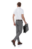 istock back view of a  smart casual man walking with  briefcase 1131987771