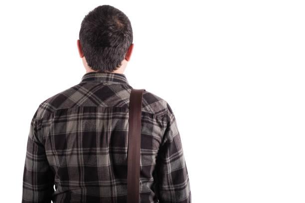Rückansicht eines jungen Mannes stehend – Foto