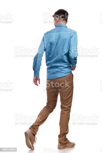 Back view of a walking casual man looking to side picture id936000654?b=1&k=6&m=936000654&s=612x612&h=hwecf4pxd7a6c9nhzyze6ix kzkoh joz v3 bgndru=
