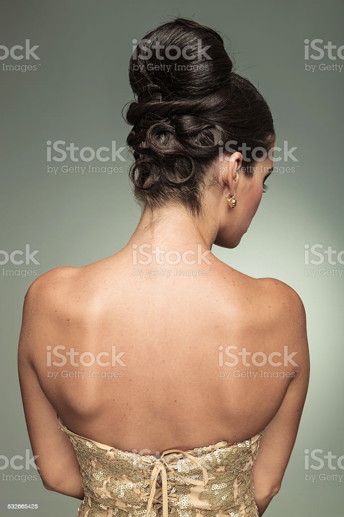 back view of a young elegant woman with nice hairstyle stock photo