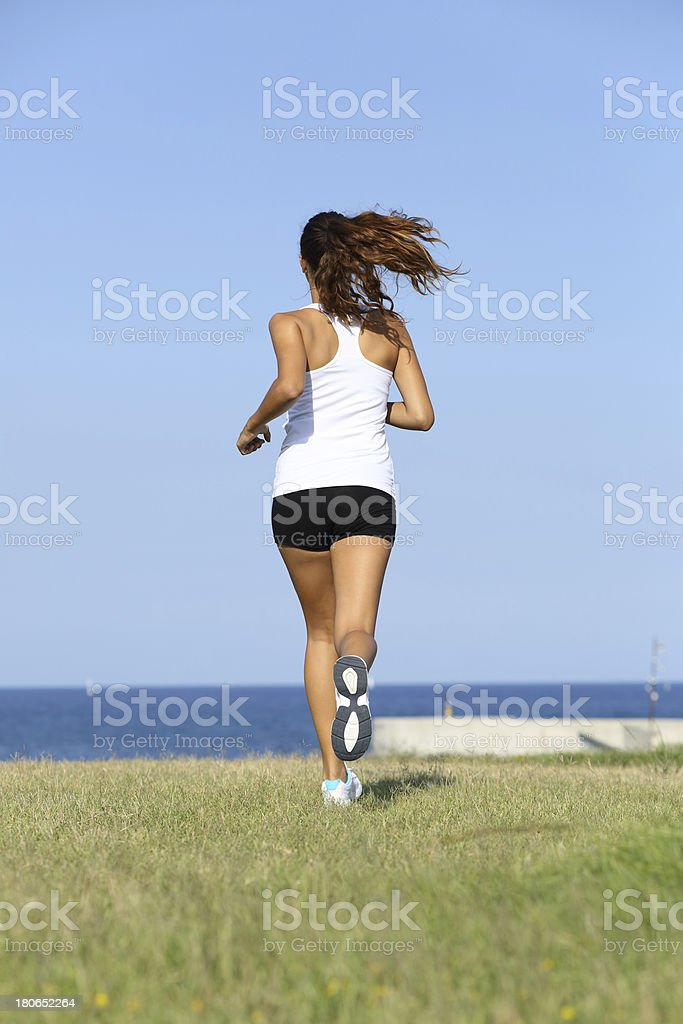 Back view of a young woman running royalty-free stock photo