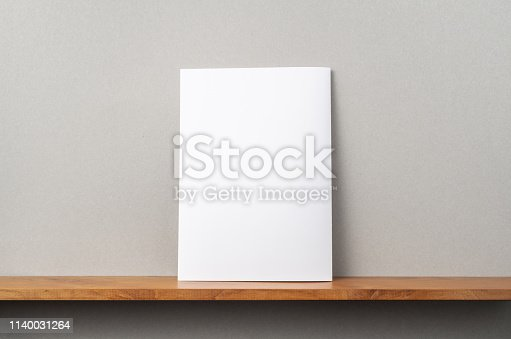 istock back view of A4 magazine stand on bookshelf 1140031264