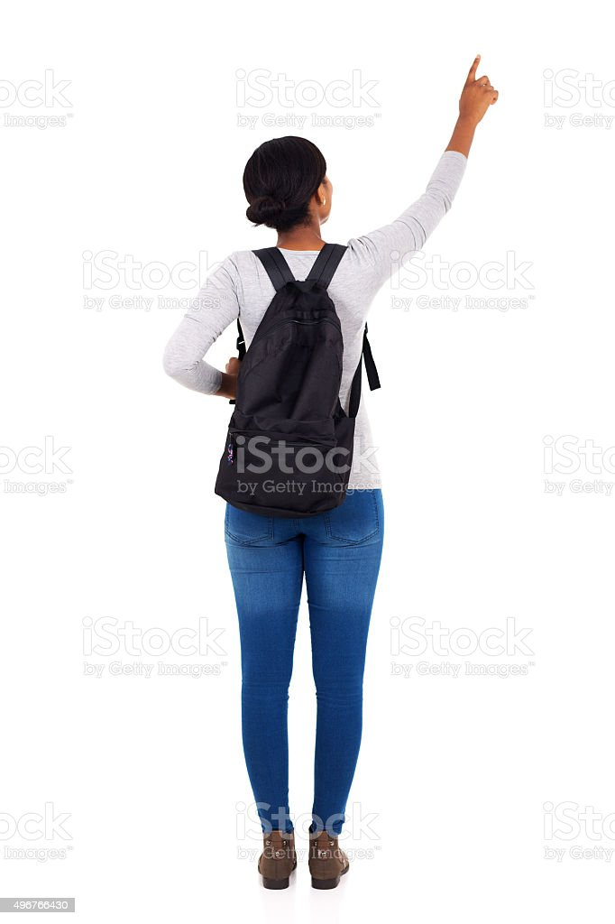 back view of african college girl pointing empty space stock photo
