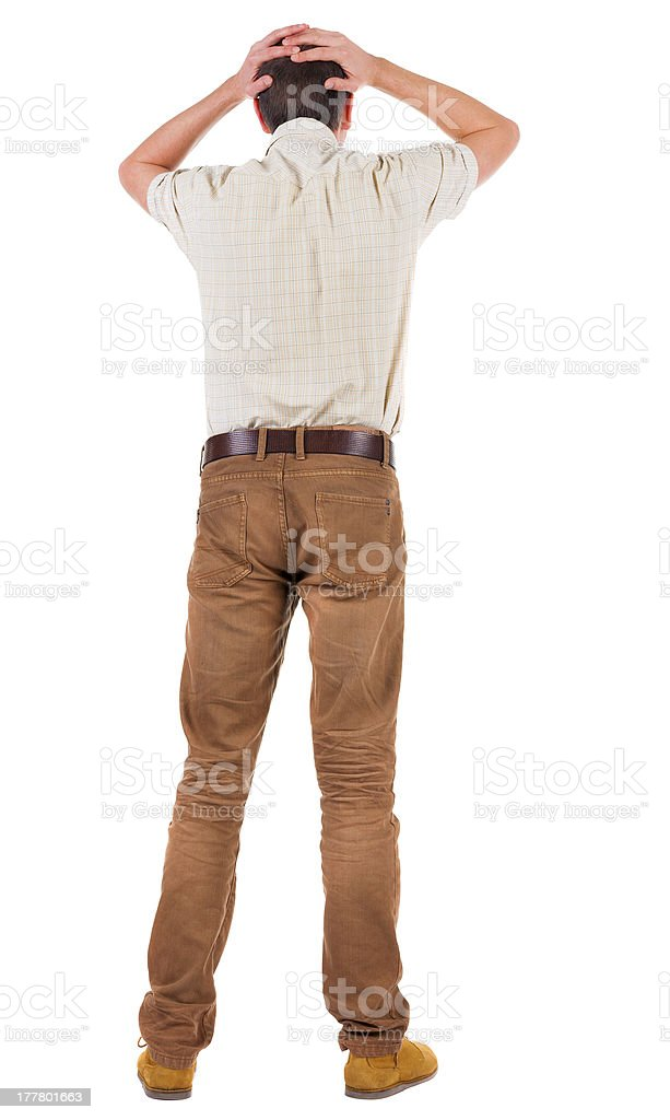 Back view of angry young man in jeans and shirt. royalty-free stock photo