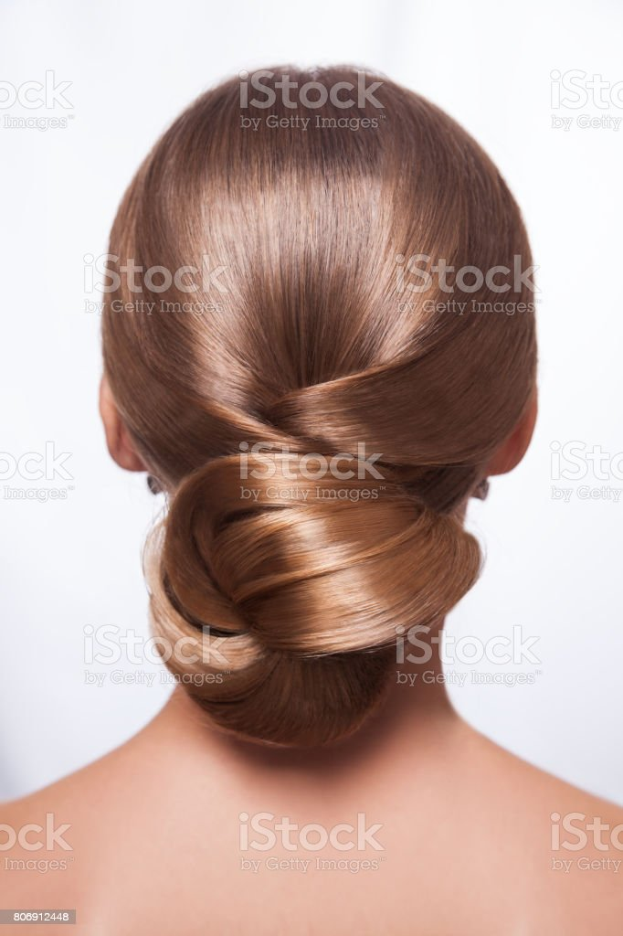 Back view of beautiful woman with creative elegant hairstyle stock photo