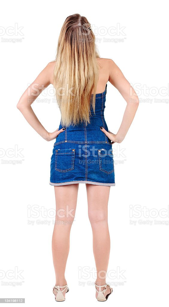 Back view of beautiful yong woman  looks ahead. rear view. royalty-free stock photo
