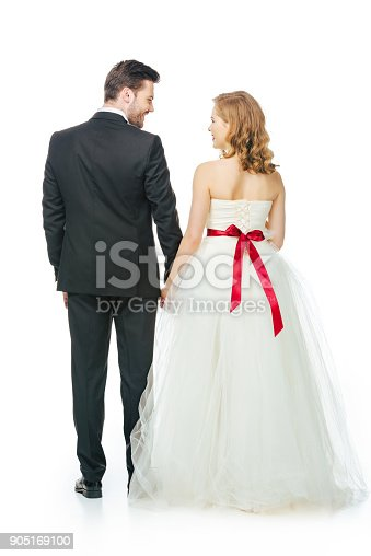 istock back view of bride and groom holding hands 905169100
