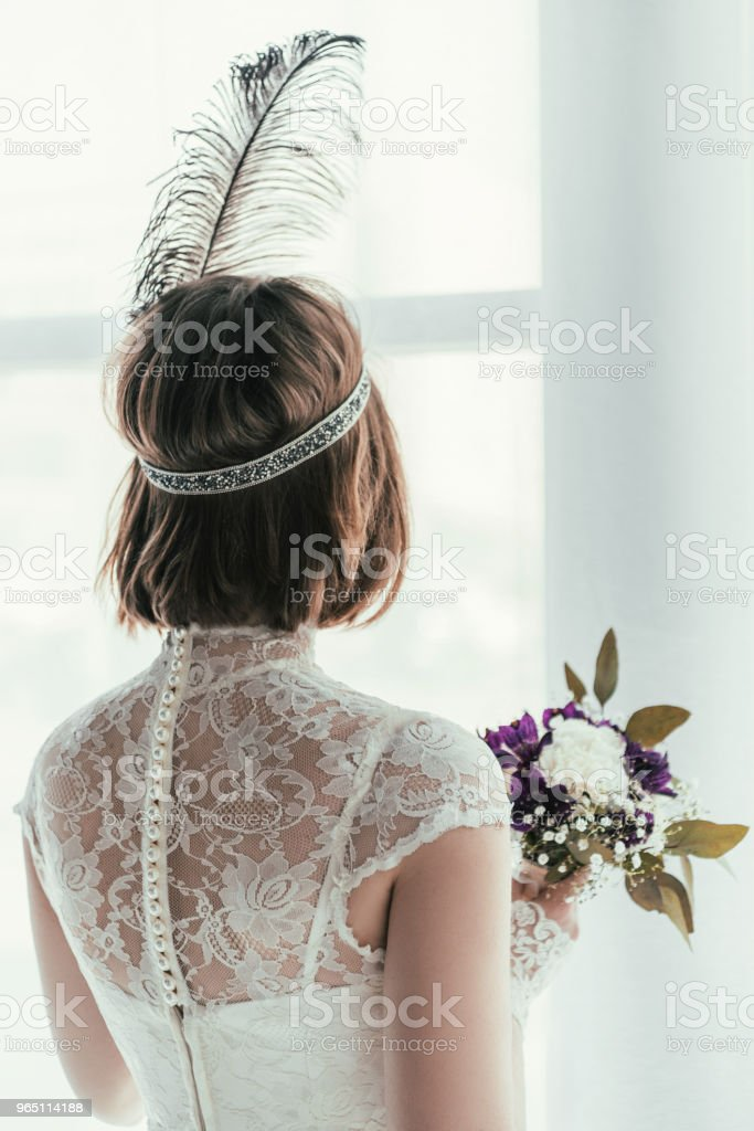back view of bride in white dress with beautiful bridal bouquet, rustic wedding concept zbiór zdjęć royalty-free