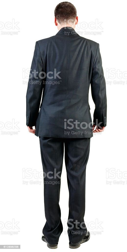 back view of business man in black suit  watching. stock photo