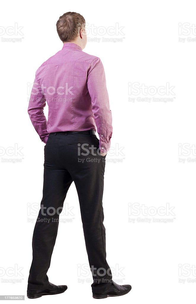back view of business man  in red shirt looks ahead. royalty-free stock photo