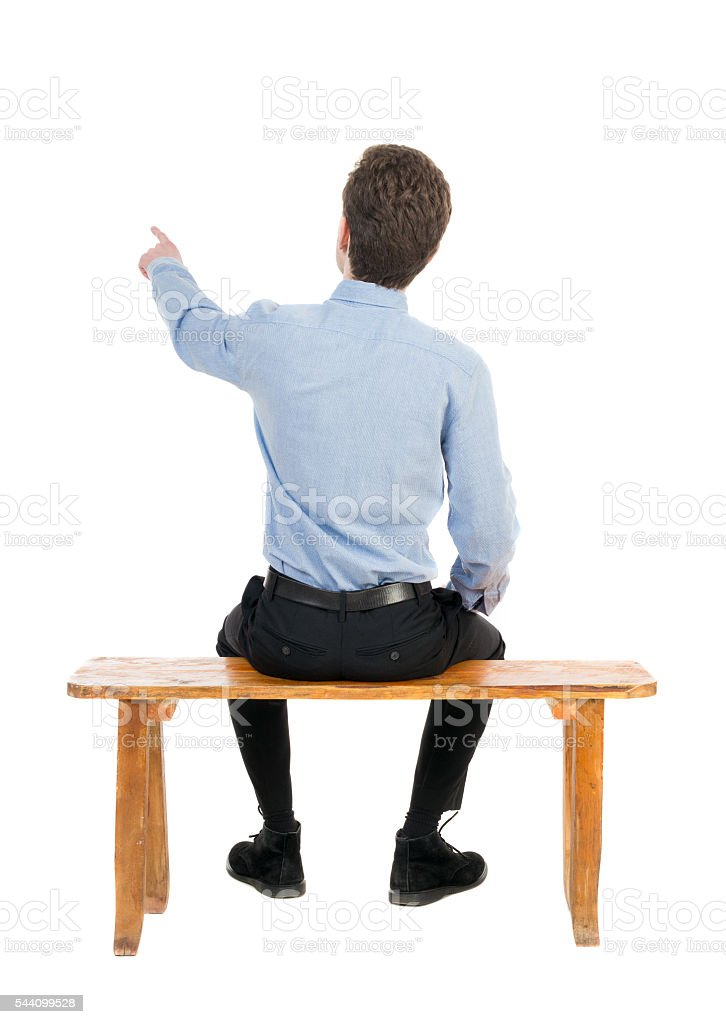 back view of business man sitting on chair and pointing ひらめきの