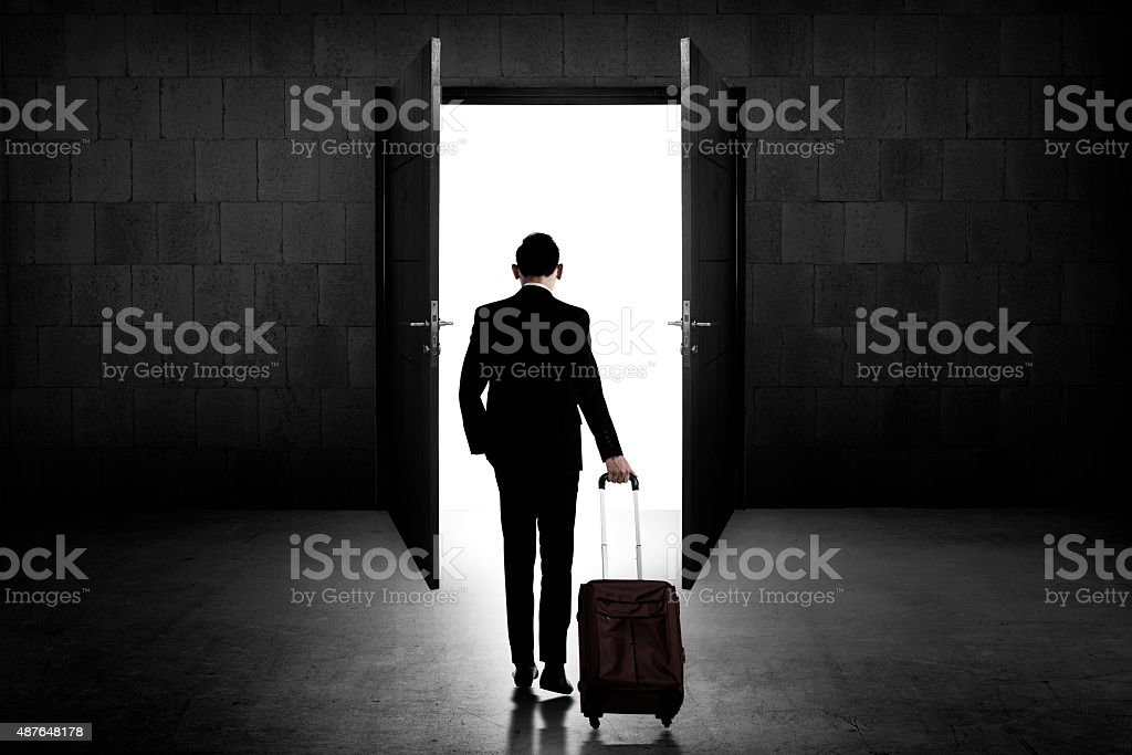 Back view of business man standing toward door stock photo