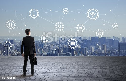 istock back view of business person and wireless communication network concept, Internet of Things, Smart City, Smart Grid, Information Communication Technology, abstract image visual 691792838