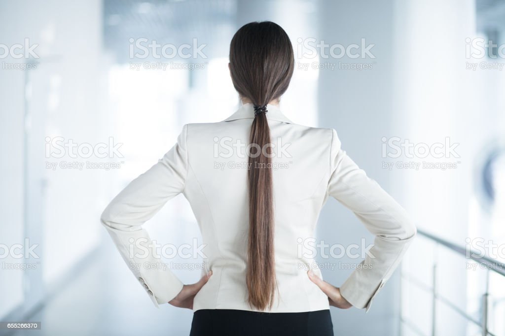 Back View of Business Woman Standing in Hall stock photo