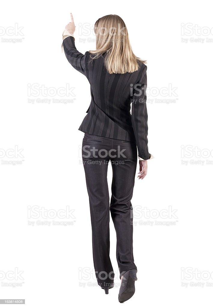 Back view of  business woman walking and pointing royalty-free stock photo