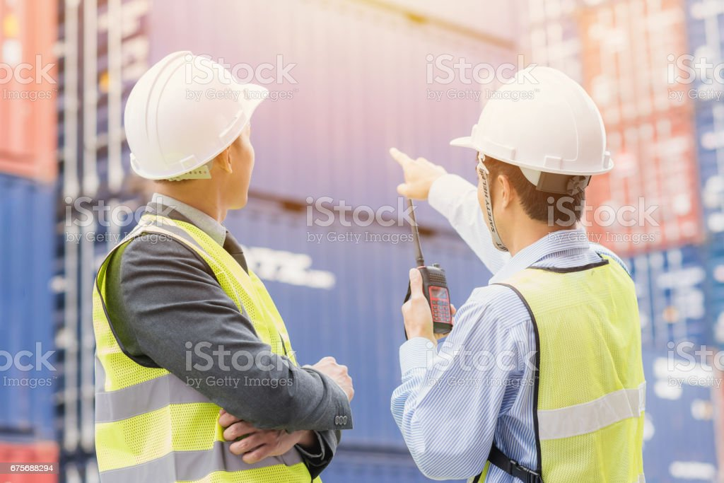 Back view of businessman with staff checking shipping cargo container freight stock photo