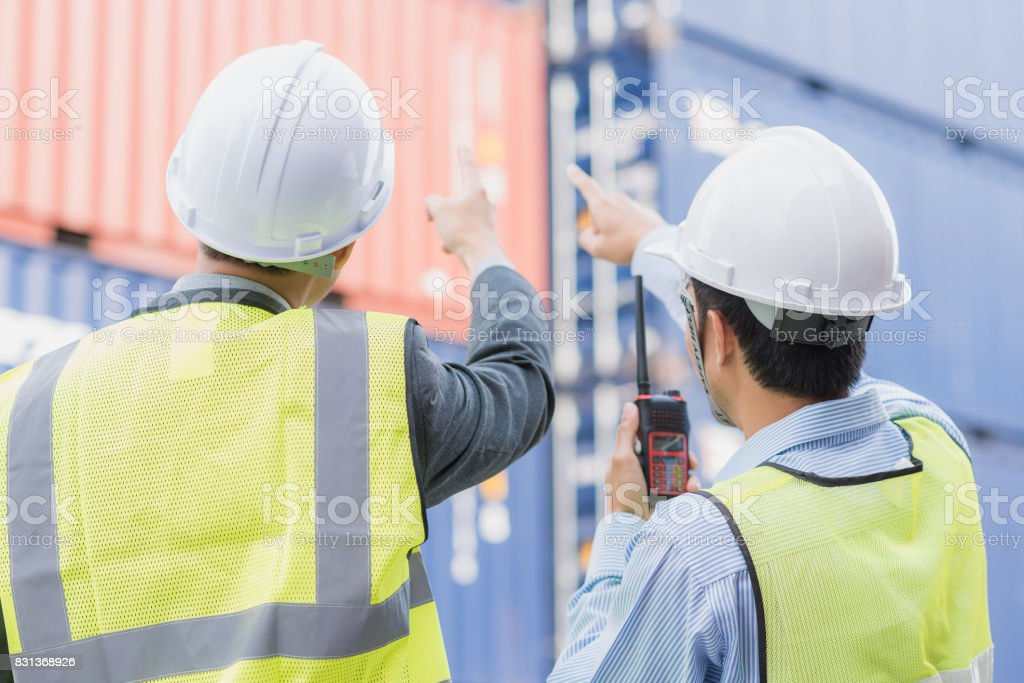 Back view of businessman with staff in logistic, export, import industry stock photo