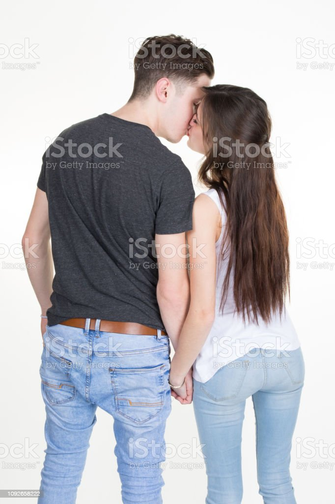 Back view of couple holding hand isolated over white kissing stock photo