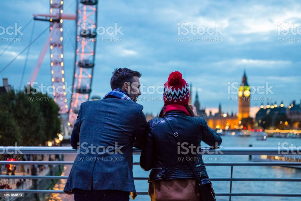 Back view of couple in London in the evening stock photo