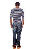 istock Back view of dark-skinned young man in jeans and  blouse 531642715