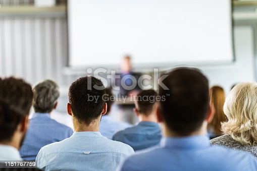 istock Back view of entrepreneurs having a training class in a board room. 1151767759