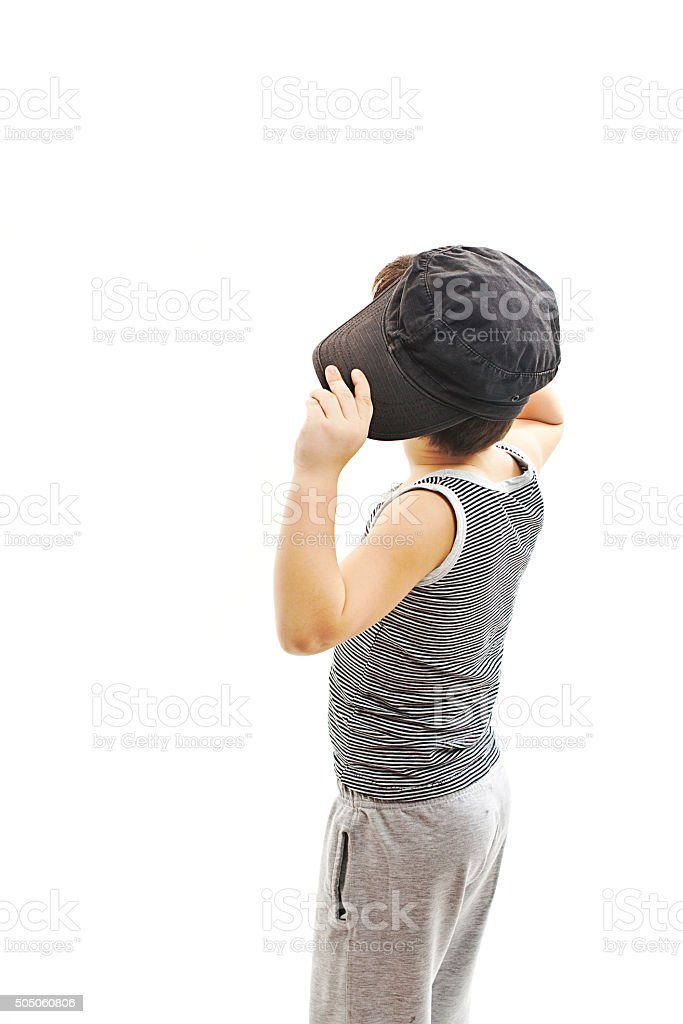 Back view of fashionable little boy.Hip-Hop Style  looking at wall stock photo