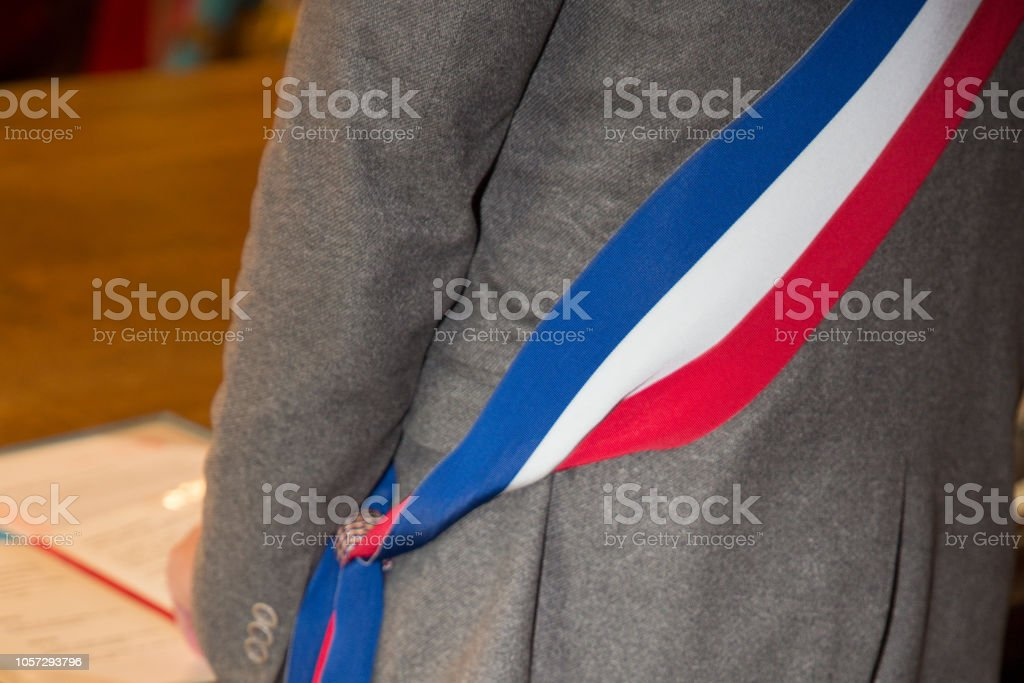 Back view of French mayor man with scarf flag during wedding celebration stock photo