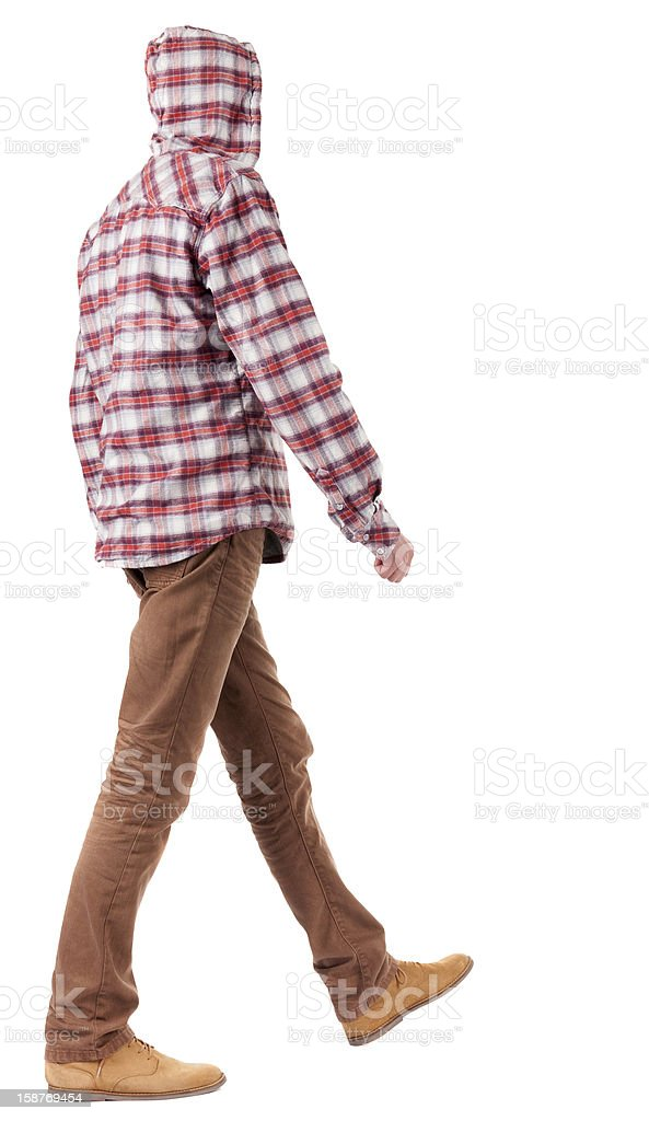 Back view of going  guy in  plaid shirt with hood royalty-free stock photo