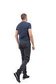 istock Back view of going  handsome man. 824207550