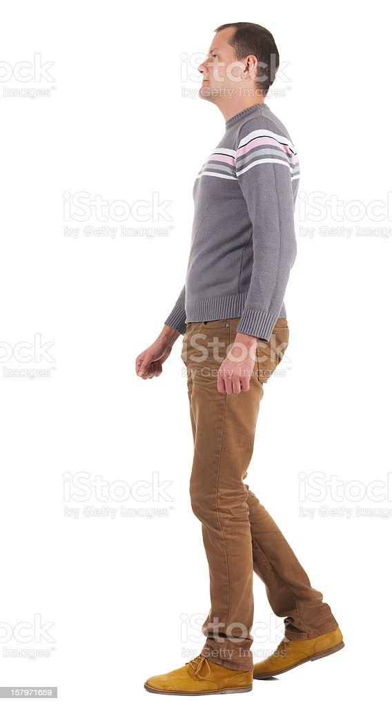 Back view of going   man in sweater and brown jeans. royalty-free stock photo