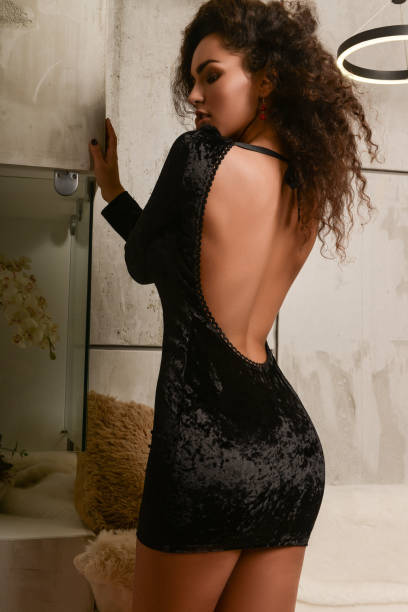 back view of gorgeous woman - mini dress stock photos and pictures