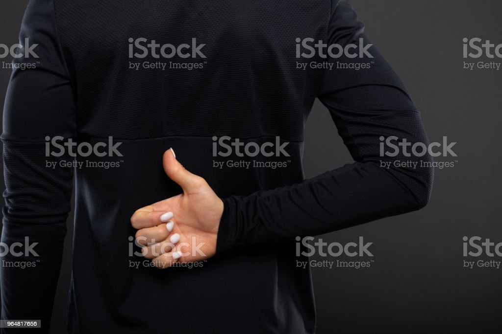 Back view of gym female trainer showing like royalty-free stock photo