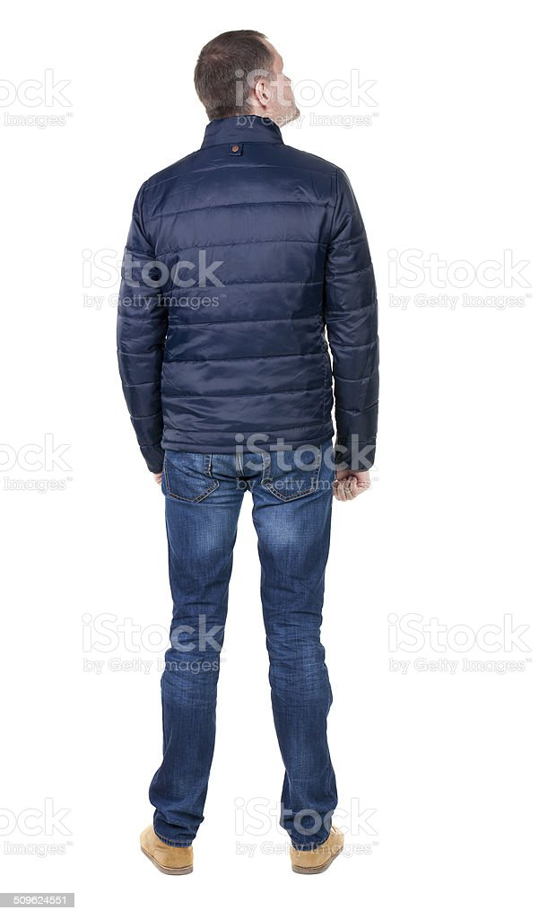 Back view of handsome man in blue windcheater looking. stock photo