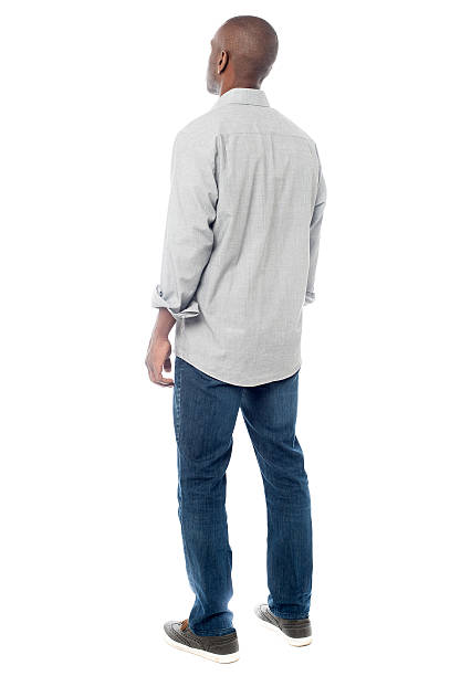 Back view of handsome man looking up stock photo