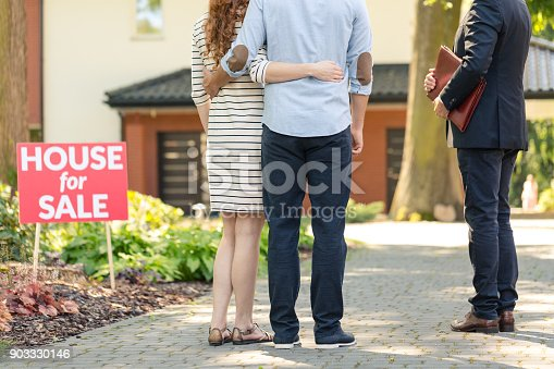 istock Back view of hugging couple 903330146